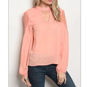 Peach long bell sleeve choker neck blouse.